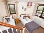 This lovely twin room has its own en-suite with bath and shower over.