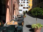 chocolate shop - Rocca Dei Perugini, blue palazzo at end - entrance to apt.