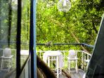 Balcony that overlooking lush garden
