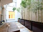 Patio Teak furniture with bamboo plants