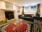 Very spacious Lounge with 2 large sofas, Apple TV, BT YouView, DVD player, books, games and fire.