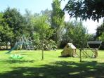 The shared garden has a children's play area and animals to feed