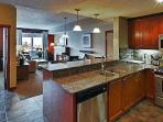 This beautiful condo features a gourmet kitchen with granite countertops