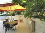 The Kalo Nero Beach Apartment Irida, with yard playing, close to pristine sandy beach of Kyparissia.
