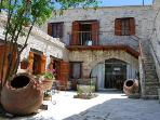 Our private courtyard near our 2 one- bedroom Apartments and the upper two bedroom Apartment.