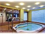 Indoor common area hot tub. Adjoins newly furnished work out gym