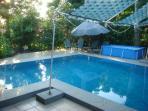 Refreshing lap swimming pool...steps to lounge on ((-: