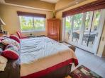 Master bedroom opens up to the breezy open air lanai.