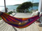 Wood deck was replaced by hurricane-proof construction. Laze in the hammock in the shade.