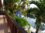 Upstairs full length balcony overlooks water