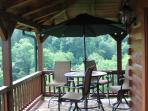 Bar table with four bar swivel chairs on the 3rd floor balcony facing the lake and the western bluff