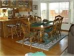 Dining Room, Bar Area ( 3 barstools), Kitchen. Table is Ex-Large, 96' long.