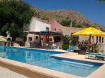 Poolside and honestybar and BBQ Finca El Capricho