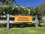 The Kingston Homestead sign made from a slab of matai