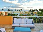 Private Terrace with a direct view to the three pools and  El Yunque (rainforest)