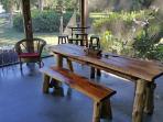 Handmade cedar table on screen porch