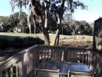 Side view from rear deck overlooking lagoon and golf course
