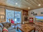 A nice cozy open living  style with cable tv, thermostat gas fire place and lots of board games.