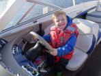 A young Scottish visitor at the helm of the Clintagh Cottages Boat