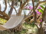 Swingbed between olive trees