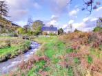 This pretty stone cottage is converted from a former chapel, in a peaceful location above the village of Llanfachreth...