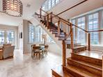 The polished stone floor and elegant staircase to the second level