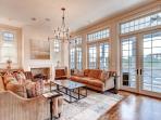 2nd floor great room has hardwood floors, recessed lighting, and open floor plan