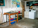 A washer, dryer and fish cleaning station in the two car garage.