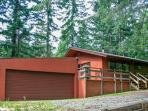 The Cabin with a detached two car garage and a remote garage door opener.