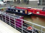 Resident canal narrow boats at the development