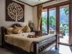 Queen size 3rd bedroom opens up to views of pool, waterfall, lake, and mountain!!