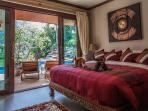 King size master bedroom with view of pool, waterfall, lake, and mountain!!