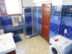 Large Master WC with shower stall, tub, towel racks for 4 persons and washing machine