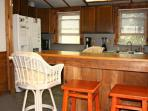 Charming cabin-style kitchen has all the amenities