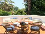 Circular veranda with view of luscious garden
