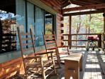Townsend Cabin #1 features a beautiful porch with plenty of seating!