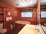 Master bath features large jacuzzi tub, a perfect place to relax after a long day of hiking or shopping!