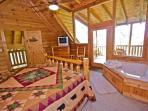 Upstairs King Bedroom with in-room Jacuzzi Tub and Bath with Walk-In Shower and Private Balcony