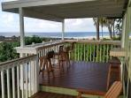 Gorgeous Views from Covered Deck with Stone Tile Bar.