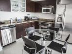 Contemporary kitchen with stainless steel appliances.