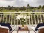 Expansive course views from your private furnished balcony with seating for up to 4 guests.