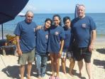 House keeping staff enjoying a day at the beach with the owner and colleague.