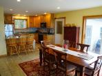 Dining room and Kitchen -Beaver Cove Home on Moosehead Lake