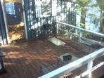 Large shaded deck with barbecue