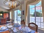 Dining room, desk, and upper patio