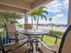 First floor corner unit with an outdoor patio just across the street to the beach