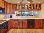Beautifully upgraded and fully equipped kitchen - plenty of custom cabinetry and counter space