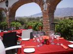 Venta El Jinete, fabulous views from outside terrace. Book in advance. Great food singers/guitar