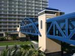 Cooled walkway over road to pool area on beachside