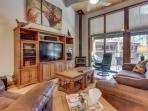 High-end condo with access to a shared pool, hot tub, sauna, and golf!